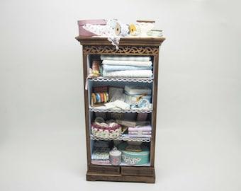 Miniature dollhouse haberdashery shelf