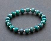 Blue wood and sterling silver beaded stretchy bracelet // Stack bracelet.