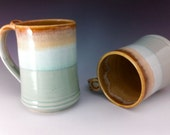 A Pair of Aqua and Caramel Mugs