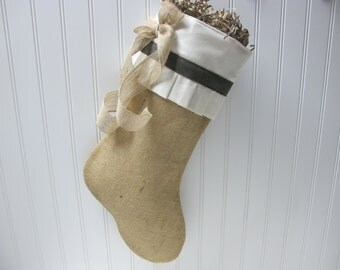 Beautiful pleated cuff on a burlap stocking with green accents and bow