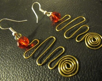 Bronze wire wrapped earrings spirals red beads