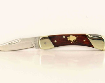 Schrade pocket knife with a custom Maple Buffalo inlay