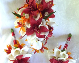 Red lily and white calla lily wedding bouquet set with orange accents
