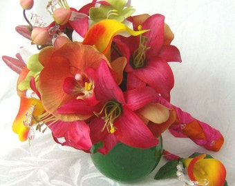 Tropical wedding bridal bouquet and matching boutonniere orange calla lilies and orchids beauty lilies destination wedding bouquet