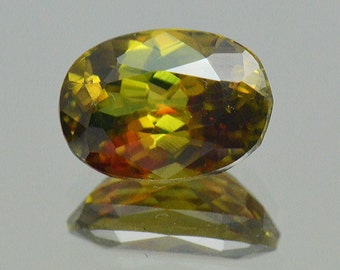 1.55CT Sphene Certified oval cut gemstone golden yellow color with green and red glints