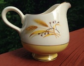 Autumn Gold creamer. Vintage milk pitcher. Tea party creamer. Yellow and white cream server. Mid Century china. Gold trimmed china.
