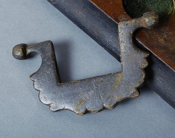 Antique brass pull handle. Very old. dark patina.