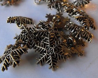 "15 Gold Snowflake Shanked Buttons Size 3/4""."