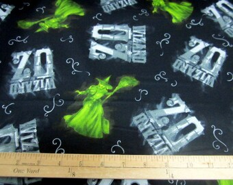 Wizard of Oz 75 Years of Wickedness - Oz and Witch Tossed on Black Fabric by Quilting Treasures