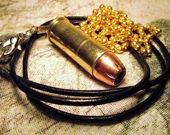 44 Magnum Real bullet and brass pendant with Faux leather or ball chain necklace. Cool gift.