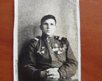 1950 Old photo of soviet soldier in military Uniform with Medals and Orders