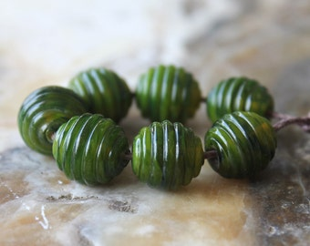 set of seven ribbed rounds seaweed green handmade glass lampwork