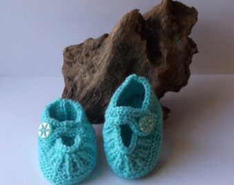 Newborn baby girls hand knitted  turquoise booties or shoes. 0 to 3 months.