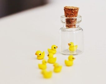 Micro rubber duck in a tiny bottle
