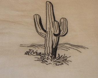 Embroidered cactus flour sack towel.