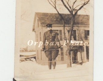 Vintage/Antique photo of woman in a military soldier uniform