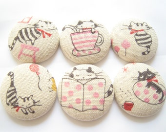 Party Cats Fridge Magnets gift set of 6 in tin. Cute fabric button magnets to adorn your fridge. Quality cotton, natural, grey and pink
