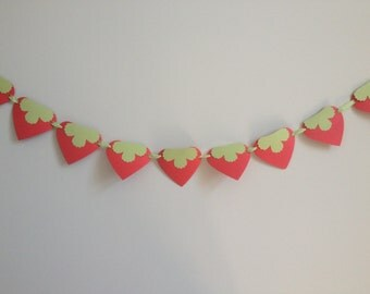 Paper party supplies-Strawberry party theme, One 6ft red and green paper strawberry banner with pink ribbon.