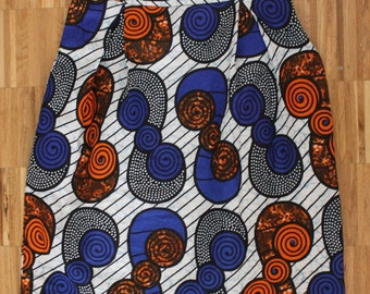 Pleated African Wax Print knee length skirt with side zipper. Size UK S. Waist 26 inches. Ships from USA