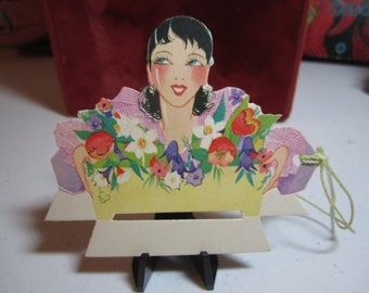 Unused art deco die cut 1920's-30's combination place card bridge tally pretty deco lady holding a planter filled with spring flowers