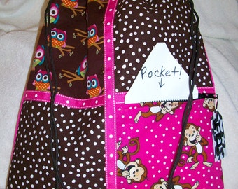 owls and monkeys with brown on a hot pink ripstop nylon drawstring backpack with front zipper pocket