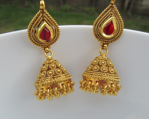 red stone gold jhumkas indian jewelry bridal earrings by