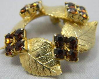 Vintage gold tone Leaf motif brooch brown rhinestones