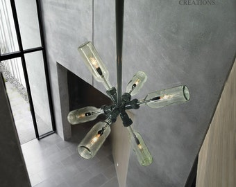 Starburst Chandelier. Wine / Beer bottles, plumbing pipe and fittings.