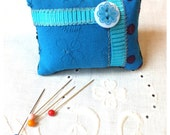BLUE PATCHWORK PINCUSHION with ribbon and a button