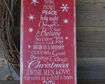 Christmas sign. Red Christmas sign, inspirational words of Christmas  in the shape of a Christmas tree. Christmas decor, Holiday decor