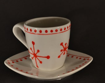 Beautiful espresso cup with little red snowflakes