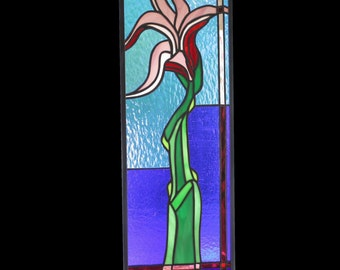 Stained glass panel of flower in blue pink green