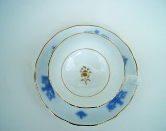 Vintage  Blue and White Tea Cup and Saucer