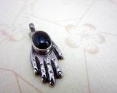 sterling silver garnet cabochon hand pendant