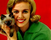 Vintage 1950's retro postcard. Girl with cat
