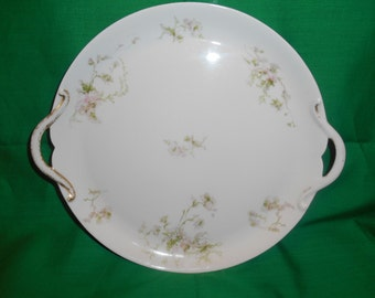 """One (1), 9 3/8"""" Porcelain Two Handled Pie Plate.  Signed GDA, France and Ch. Field Haviland, Limoges."""