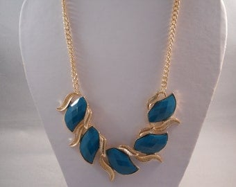 Gold Tone and Blue/Green Pendants on a Gold Tone Chain