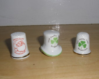 Vintage Souvenir Thimbles -  Two Lucky Irish Shamrock Thimbles and One Santas Village Bracebridge Thimble