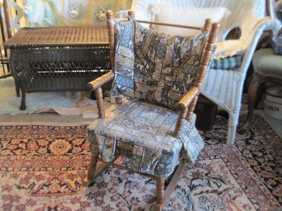 Vintage child s rocking chair cricket style with a ladder back