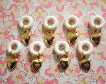 8 Goldplated Hearts on Lucite Ring