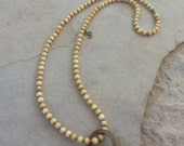 karma mala (108 bead meditation necklace) - antiqued bone with African brass ring