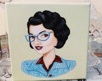 Evette, a beautiful vintage woman wearing stylish glasses.