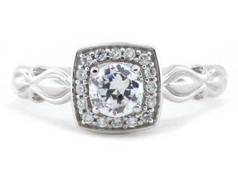 Carved Shank Engagement Ring, Diamond Halo, and 5 mm Forever Brilliant Moissanite Center Name Cleo