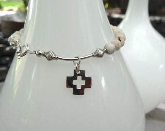 Sterling silver and 6mm white turquoise cross bracelet.