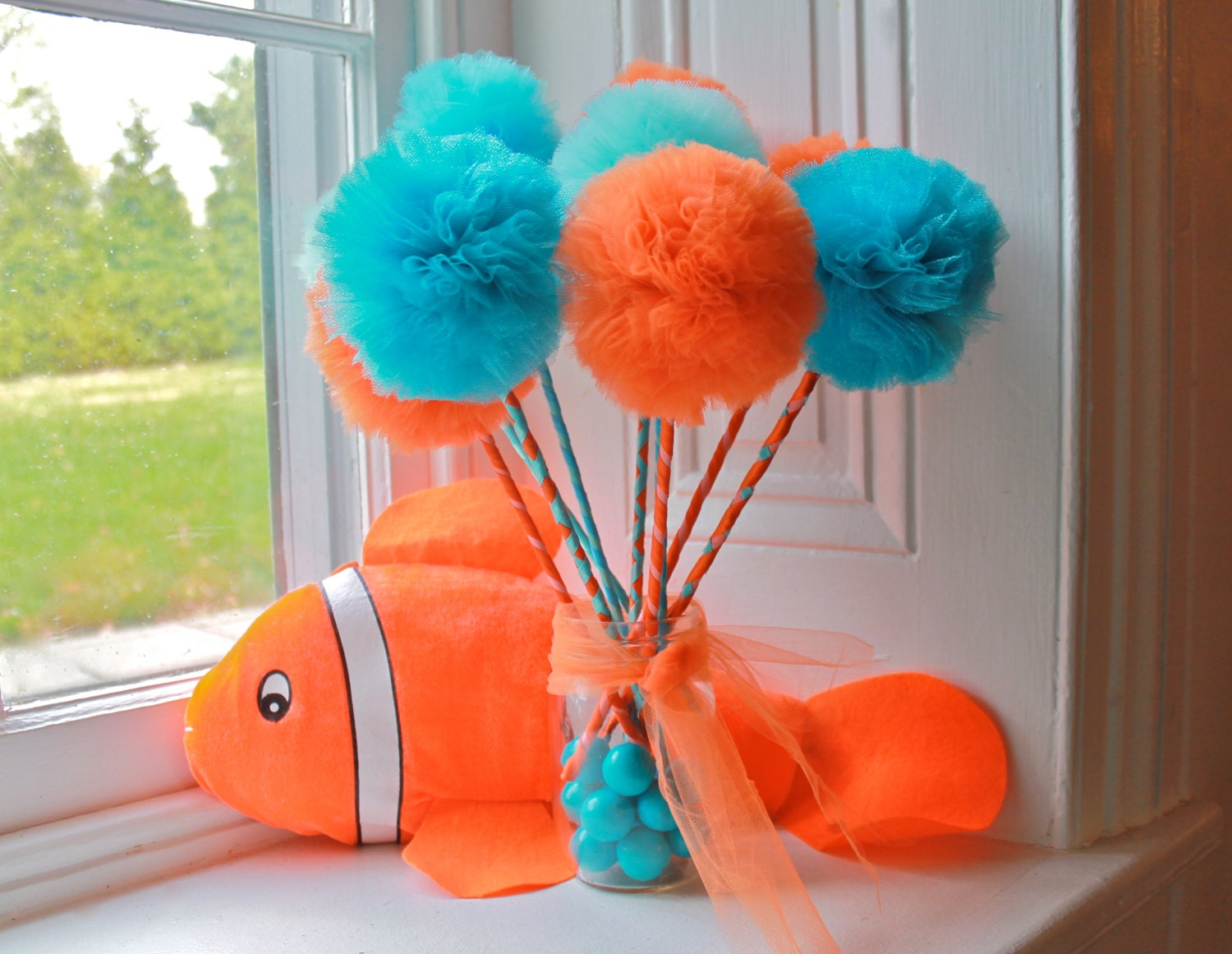 Orange and turquoise nemo or dory inspired party favors for Nemo decorations