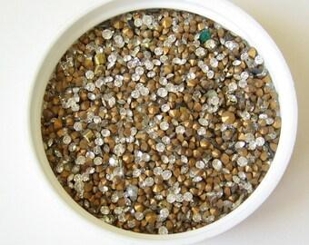 2.5 grams Swarovski small clear crystal rhinestone chatons.  Mixed sizes