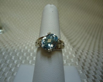 Oval Checkerboard Cut Blue Topaz Ring in Sterling Silver