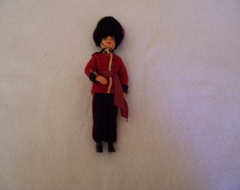 Vintage celluloid doll - British soldier/bobby - from the UN