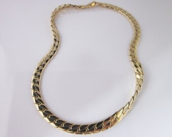 Articulated necklace in metal gold tone