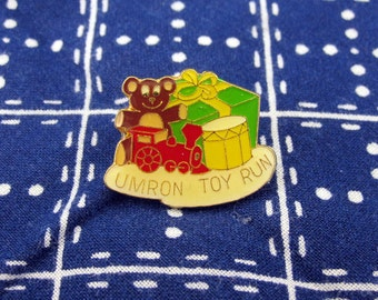 Vintage UMRON Toy Run Motorcycle Pin 1980's